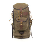 Summit Boulder Jct. by Frost River shares the same pack body as the Summit Pack then adds a buckled front pocket, a bottom zip compartment, and cinch compression cord along the height of the pack.