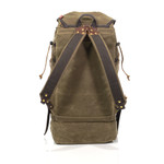Waxed canvas padded shoulder straps get reinforced with cotton webbing and are solidly riveted to a brass ring at the top of the straps. The ring offers adaptability to varying shoulder widths and allows the pack just enough independence to be comfortable on a back.