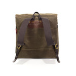 The straps are made of webbed cotton and attached to the pack by solid brass hardware. This bag is made in the USA by Frost River.