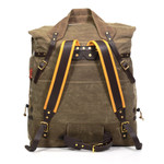 A back view shows the buckskin padded back-straps and tumpline of the pack. The combination allows a person to change where the weight of the load rides on a body. The tumpline goes at the top of the forehead to shift the load straight down the spine and take the weight off the shoulders. Additionally there's a waist-belt for stability and a leather cinch strap and cord lacing up each side to keep contents where they belong.