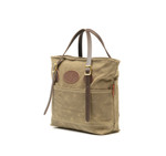 The Canal Park Tote is crafted from waxed canvas, premium leather, and solid brass hardware. This product is made in Duluth, MN and comes in field tan or heritage black.