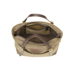 An inside view of this tote shows a lot of storage, a zipper pocket, and a zipper on top to enclose the contents of this versatile tote.
