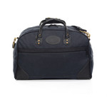 The Heritage Black Curtis Flight Bag has leather on the bottom corners to keep the bag upright when standing by itself. The Front of the bag has a zipper pocket for important items or to store the shoulder strap when not in use.