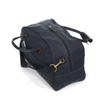 The two bridle leather handles are attached to the Curtis flight bag by solid brass hardware.