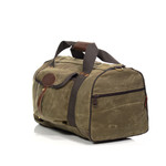 Explorer Duffel ESB by Frost River has the shoulder straps tucked away in their sleeve for this photo. The bag stays streamlined and snag-free with the straps tucked in.