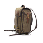 All compartments are closed with leather straps and solid brass hardware.