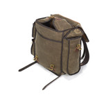 The top of the bag has two leather straps and two waxed canvas flaps to ensure that your items inside are secured well.