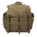 The Timber Cruiser pack is a larger version of the Timber Cruiser Jr. pack. It maintains the heavy duty features including padded buckskin straps, waxed canvas, leather, and solid brass hardware.