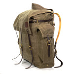 This American made product has two large pockets on the sides. Both are secured with leather straps and solid brass hardware.