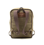 The backpack straps are secured to the bag with solid brass hardware to make sure that the straps last for the lifetime of the day pack. This item is crafted in Duluth, MN at Frost River.