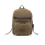 The North Bay Daypack is made with waxed canvas, webbed cotton, premium leather, and solid brass hardware in Duluth, MN.