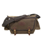 This American made messenger bag has a cross-body cotton strap with a leather pad for comfort and grip.