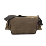 The back view shows the beauty of the quality waxed canvas and what the side pockets will look like when snapped shut.