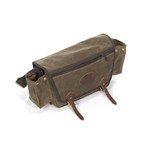 Side pouches open up large enough to hold a water-bottle, thermos, or a travel mug. It can also be securely shut with its brass snaps to hold small items.