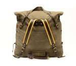 Lewis & Clark Canoe Pack No.754 by Frost River. Back view shows the buckskin padded back-straps, tumpline, waist-belt, side cinch cords, leather compression strap, and waxed canvas construction throughout. Made in U.S.A.