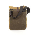 The satchel has a large slip pocket for a phone, tablet, or important documents.
