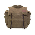 The Timber Cruiser Jr. pack is a smaller version of the Timber Cruiser pack. It maintains the heavy duty features including padded buckskin straps, waxed canvas, leather, and solid brass hardware.