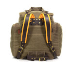 The back of the pack features a waist-belt, tumpline, and padded buckskin straps for added comfort and support on long portages.
