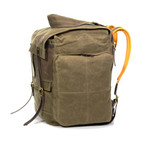 This pack has two buckskin straps and water-repellent waxed canvas flaps to keep all of your knick-knacks securely inside.