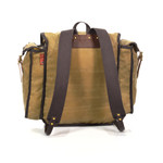 The back shows the high quality and comfortable straps that are attached with hand pounded solid brass hardware.