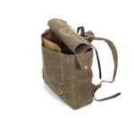 A slip pocket on the front can hold the essentials and the two side flaps have grommets for an added feature.