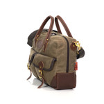 This American crafted bag has a leather base, a large zippered interior pocket, and many exterior storage options.