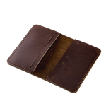 The interior of the Pocket Folio has a slot on each side that can fit a small notebook, passport, or receipts plus four slots for a credit card.