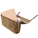 The slip pocket can hold a cutting board and the two pull zipper can hold a plano box. The bag itself is made of waxed canvas, leather, and solid brass hardware.