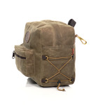 This made in America pack has side laced cord that can secure more items or sinch in the bag.