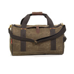 The wide green cotton web handles go all the way around the circumference of the bag to offer confidence when hefting the heavy weight of a full duffel.
