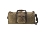 The large Explorer Duffel by Frost River is made from 'field tan' colored waxed canvas. It comes with a shoulder strap and wide green cotton webbing.