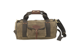 The small Explorer Duffel by Frost River is made from 'field tan' colored waxed canvas. It comes with a shoulder strap and wide green cotton webbing.