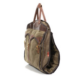 A side view shows the spacious front pocket and the large leather handles the keep the bag folded when traveling.
