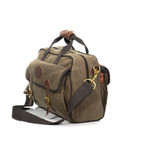 This briefcase has a cotton shoulder strap and two carrying handles that are able to be bound by high quality leather and brass snap when on the go.