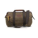 The Gladstone Tool bag is made from waxed canvas, webbed cotton, solid brass hardware, and premium leather in Duluth, MN.