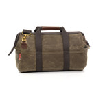 The Tool Bag version of this product has pockets on the interior and exterior for added organization. This version also has a padded bottom to protect the contents of the Gladstone Bag.