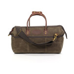 The Carry-On version of this bag has bridle leather handles attached to the waxed canvas with solid brass hardware. This pack is sturdy, durable, and ready to preform.