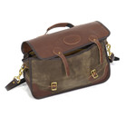 Leather straps and brass hardware securely close the briefcase so that all of the goods inside are safe.