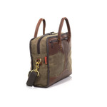 A side profile shows a long zipper on top of the bag that gives easy access to the interior of the bag.