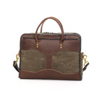 Bridle leather handles are attached to the Single Briefcase by solid brass hardware to ensure that the bag is the highest of quality.