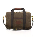 The Simple Brief by Frost River is made of waxed canvas, webbed cotton, and solid brass hardware.