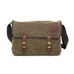 Carrier Brief Messenger Bag No.891 by Frost River. The waxed canvas is a brown / green color called 'Field Tan' the wide green cotton web strap is adjustable and long enough (generally) to wear the bag across the body. Brown leather straps attach to solid brass buckles to keep the main flap closed. This and all Frost River bags are made in Duluth, Minnesota in the USA.