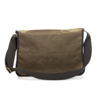 Carrier Brief Messenger Bag No.891 by Frost River with the main flap open. There's a full width slip pocket at the front, a large main opening in the center, an organizing panel near the back with a full width zip compartment at the back. The wide web shoulder strap is riveted and sewn to make a secure attachment point.