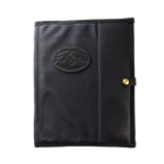 The Padfolio in Heritage Black by Frost River is made in America out of waxed canvas, premium leather, and solid brass hardware.