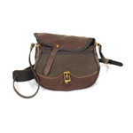 The leather flap is secured with solid brass hardware to keep the contents securely inside.