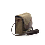 The leather shoulder strap and shoulder pad allow for this bag to be carried comfortably. This item is lifetime guaranteed and only gets better with time.