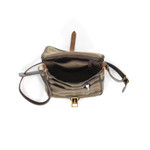 The interior of the Field Satchel is roomy and showcases pockets and slips for organization.