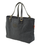 This tote snaps together for added security. The durable and strong leather straps will keep the bag on your shoulder.