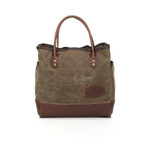 The premium version of this tote has a premium leather bottom. This item is proudly made in the USA at Frost River and available in two sizes.