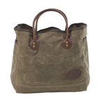 The large Lake Michigan Tote is made of waxed canvas, premium leather, and solid brass hardware.